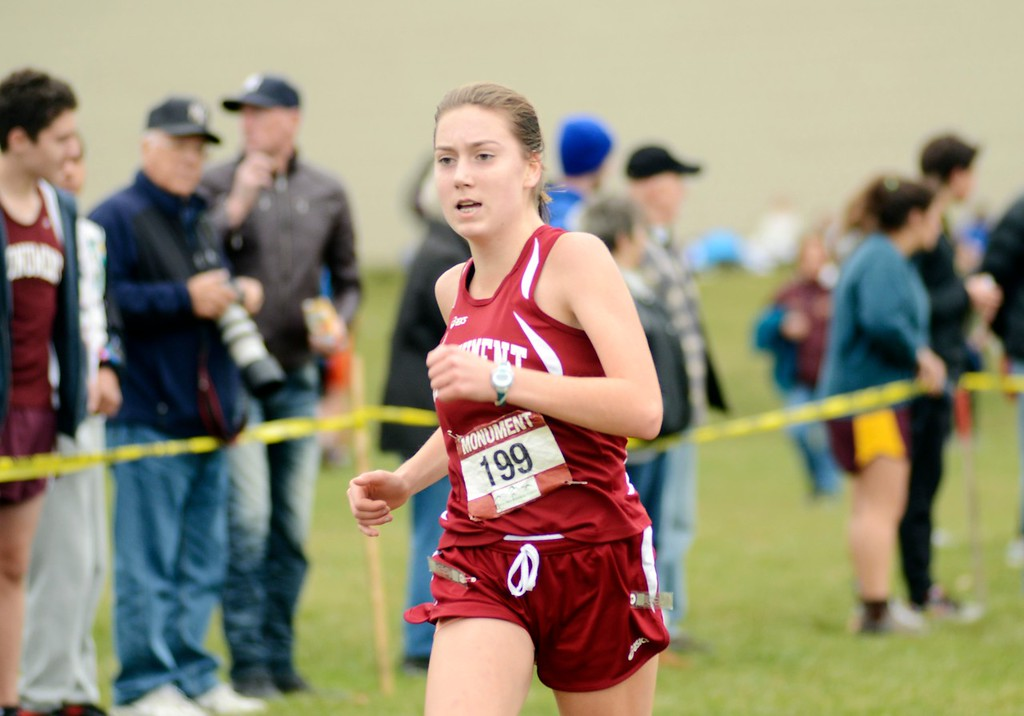 . Monument Mountain runner Grace Phair prepares to cross the finish line at Saturday\'s Berkshire County Championships at Berkshire Community College. Phair finished fifth overall in the girls varsity race.