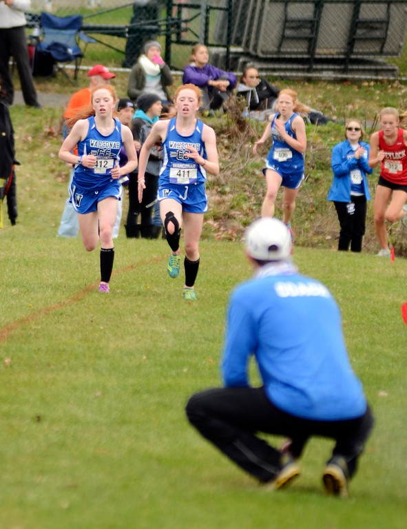 . Wahconah cross-country coach Matt Pegorari watches as his runners Danielle and Gabrielle Orlando prepare to cross the finish line at Saturday\'s Berkshire County Championships at Berkshire Community College.