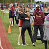 GEOFF SMITH — THE BERKSHIRE EAGLE<br /> Mount Greylock's Josie Smith hugs one of her coaches after winning the two-mile race at the Berkshire County Individuals meet on Saturday at Hosoac Valley.