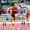 GEOFF SMITH - THE BERKSHIRE EAGLE<br /> Monument Mountain's Allison Kinne runs over a hurdle during the 400-meter hurdle race at the Berkshire County Invitational. Kinne finished first overall in the race.