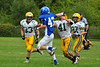 Anthony Follet holds off Taconic defense and moves down the side of the field. (Jack Guerino/ North Adams Transcript)