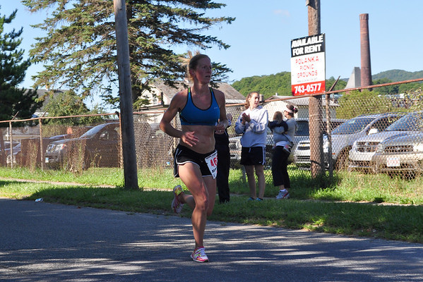 Michelle Kroboth, from Pittsfield, was the first woman to cross the finish line during the Dash for Dana in Adams on Sunday, Aug. 11, 2013. Competitors could either participate in a one mile walk or a 5K run. <br /> (Jack Guerino/ North Adams Transcript)