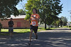 Travis Ciempa, of Adams, crosses the finish line during the Dash for Dana 5K road race in Adams  on Sunday, Aug. 11, 2013. Ciempa was the first participant to cross the finish line. He finished with a time of 17.35. <br /> (Jack Guerino/ North Adams Transcript)
