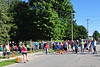 Spectators wait for friends and family to cross the finish line during the Dash for Dana in Adams on Sunday, Aug. 11, 2013. Competitors could either participate in a one mile walk or a 5K run. <br /> (Jack Guerino/ North Adams Transcript)