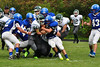 Brandon Koprowki holds onto the ball and fights off multiple Greenfield defenders. (Jack Guerino/ North Adams Transcript)