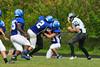 Mark Marin tackles a Greenfield defender. (Jack Guerino/ North Adams Transcript)