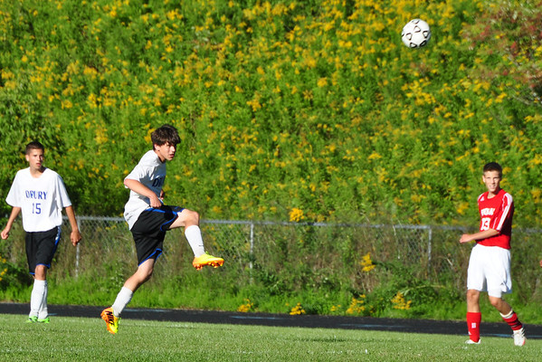 Chris Andrews sends the ball to Drury forwards from midfield. (Jack Guerino/ North Adams Transcript)