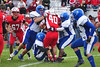 Ian Hill is brought down by the Drury defensive line. (Jack Guerino/North Adams Transcript)