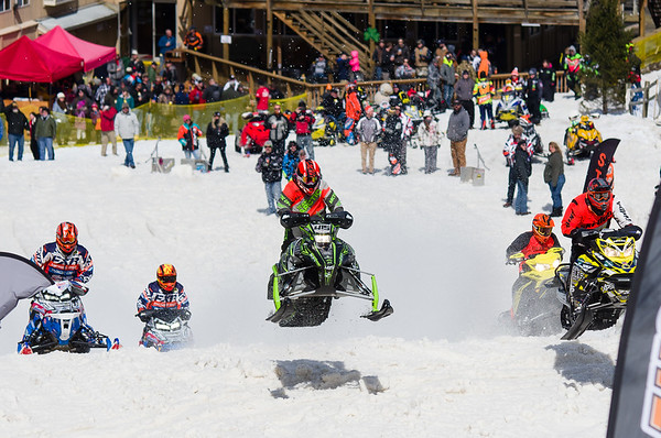 Owen Gagne (center, 415) catches air off the ramp on the start of the course at Bosquet Ski Resort Saturday.
