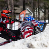 Aiden Reynolds ascends the steep first hill of the snowcross course at Bosquet Ski Resort Saturday.