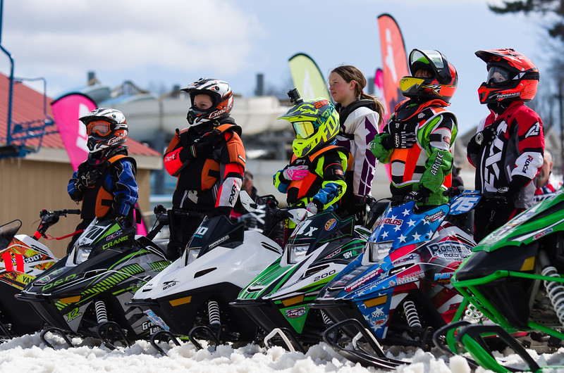 Racers line up for the national anthem before the East Coast Snowcross finals start Saturday at Bosquet Ski Resort.