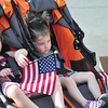 Cailyn, 3, and Tierney Rochelo, 2, hold American Flags as they wait to be pushed in the 28th annual 5k Independence Day race in Pittsfield this Thursday July 4, 2013. Photos by Sarah Howard / Special to The Eagle.