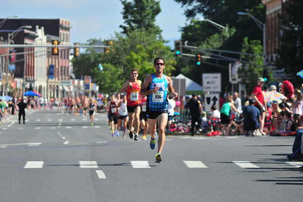 Kevin Quadrozzi led in the Independence Day 5k race through Pittsfield this Thursday July 4, 2013, coming in first at 15:57 over 1,400 runners. Photos by Sarah Howard / Special to The Eagle.