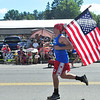 Zachary Sondrini carried an American flag as he ran the annual Independence Day 5k this Thursday July 4, 2013 in Pittsfield. Photos by Sarah Howard / Special to The Eagle.