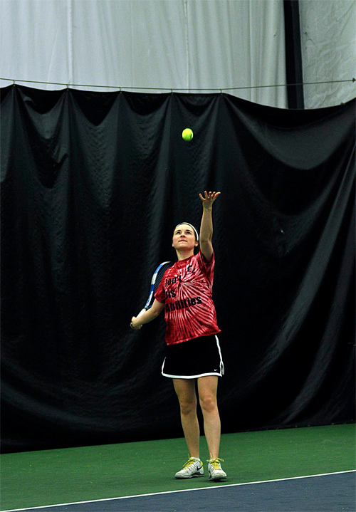 Description of . Emily Martin tosses the ball up for a serve during practice Friday, March 28, at Berkshire West in Pittsfield. Josh Colligan / Berkshire Eagle Staff / photos.berkshireeagle.com