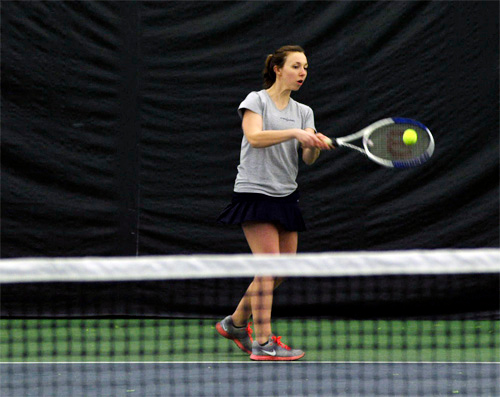 . Ashley Glass hits a backhand return during practice Friday, March 28, at Berkshire West in Pittsfield. Josh Colligan / Berkshire Eagle Staff / photos.berkshireeagle.com