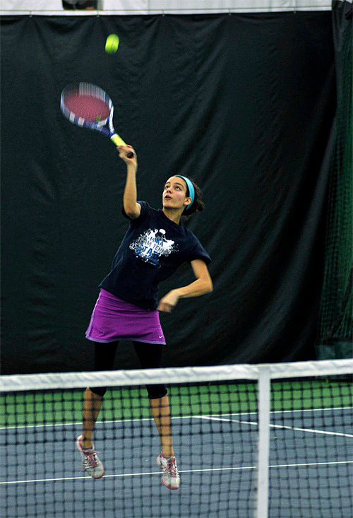 . Cara Freaman works on an overhead smash during practice Friday, March 28, at Berkshire West in Pittsfield. Josh Colligan / Berkshire Eagle Staff / photos.berkshireeagle.com