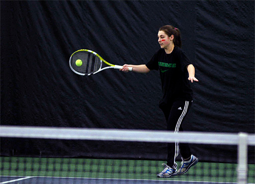 . Hailey Higgins watches her racquet hit the ball on a forehand return during practice Friday, March 28, at Berkshire West in Pittsfield. Josh Colligan / Berkshire Eagle Staff / photos.berkshireeagle.com