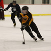 Mount Everett's Luke Murphy brings the puck up ice during a drill at practice. (Matthew Sprague / Berkshire Eagle Staff)