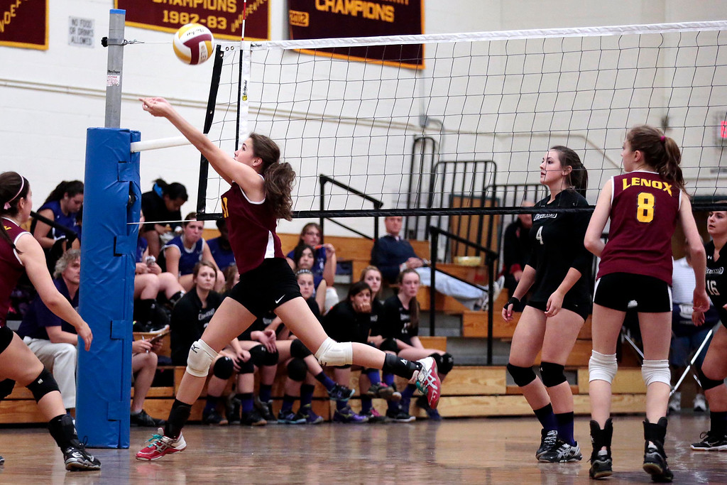 . Lenox\'s Sophie Silverstein jumps for the ball during a volleyball game against Pittsfield at Lenox Memorial High School. Monday, September 23, 2013. Stephanie Zollshan/Berkshire Eagle Staff.