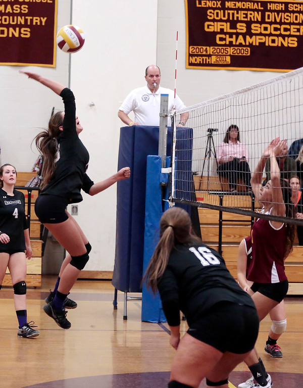 . Pittsfield\'s Paige Hamilton jumps up to spike the ball during a volleyball game at Lenox Memorial High School. Monday, September 23, 2013. Stephanie Zollshan/Berkshire Eagle Staff.