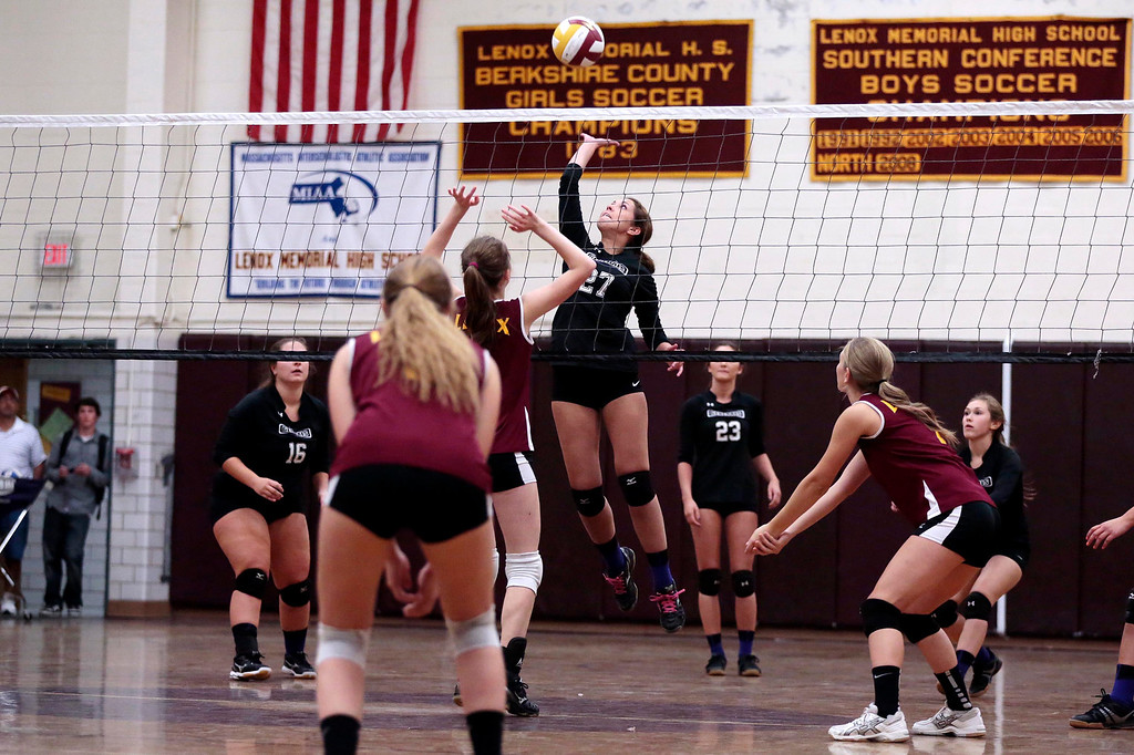 . Pittsfield\'s Emma Burnick jumps up to spike the ball during a volleyball game at Lenox Memorial High School. Monday, September 23, 2013. Stephanie Zollshan/Berkshire Eagle Staff.