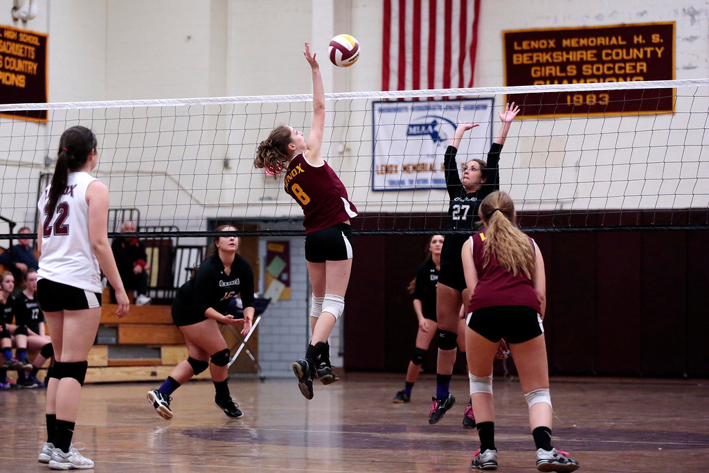 . Lenox\'s Lizzy Barry spikes the ball during a volleyball game against Pittsfield at Lenox Memorial High School. Monday, September 23, 2013. Stephanie Zollshan/Berkshire Eagle Staff.