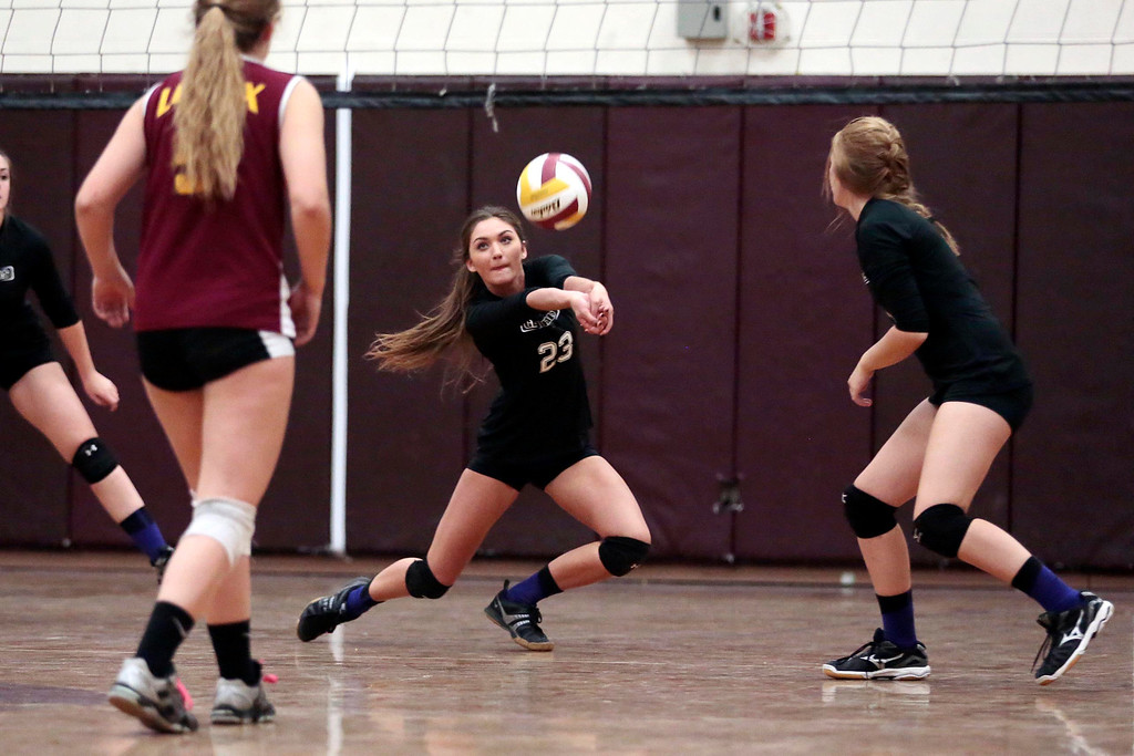. Pittsfield\'s Paige Hamilton dives for the ball during a volleyball game at Lenox Memorial High School. Monday, September 23, 2013. Stephanie Zollshan/Berkshire Eagle Staff.