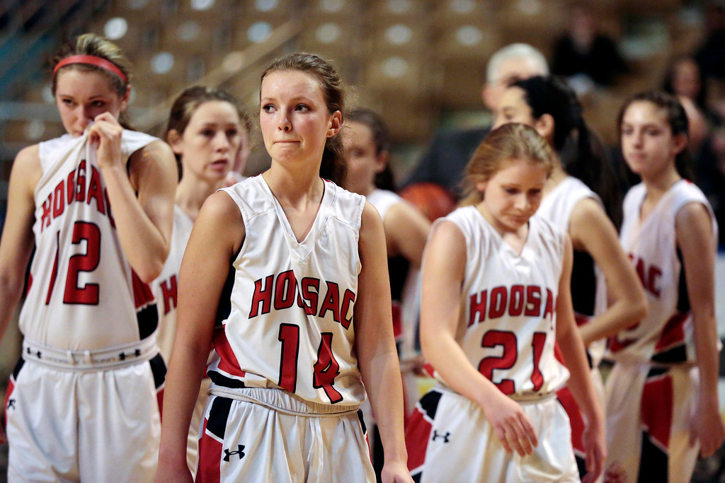 . The Hoosac girls basketball team walks back to their bench dejected after being defeated by St. Mary\'s in the state championship game in Worcester. Saturday, March 15, 2014. Stephanie Zollshan / Berkshire Eagle Staff / photos.berkshireeagle.com