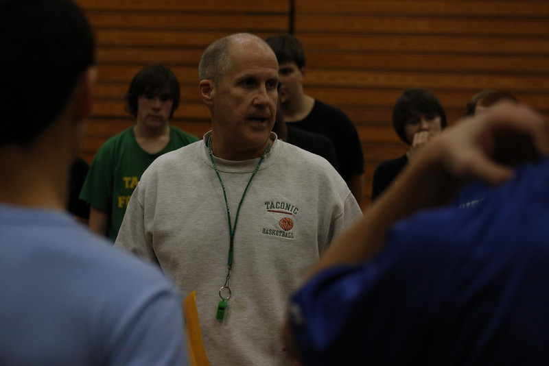 Taconic boys basketball coach Bill Heaphy addresses prospective players during the first day of tryouts. (Matthew Sprague / Berkshire Eagle Staff)