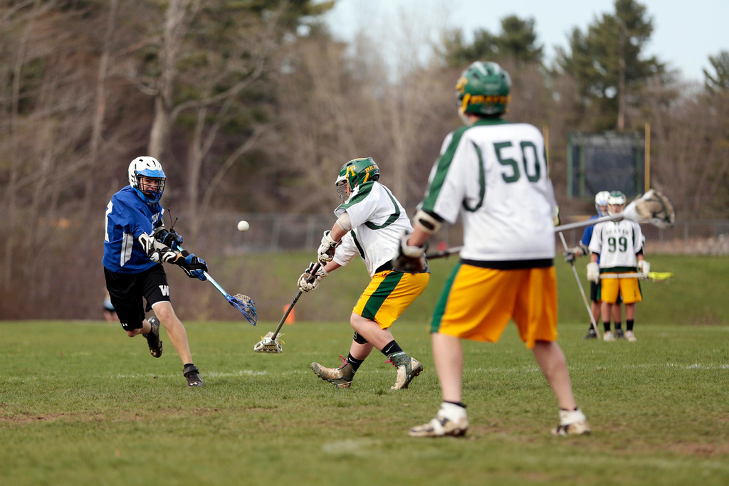 . Wahconah\'s Nick Clayton takes a shot and scores during a lacrosse game at Taconic High School in Pittsfield. Wednesday, May 7, 2014. Stephanie Zollshan / Berkshire Eagle Staff / photos.berkshireeagle.com