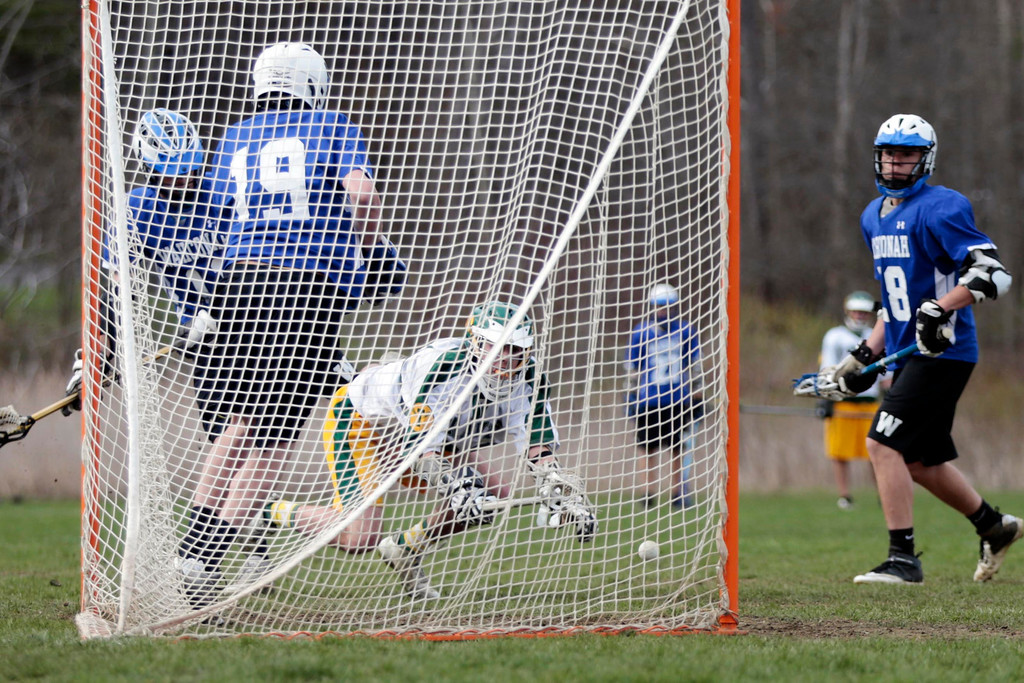 . Despite falling, Taconic\'s Mike Perkett scores a goal during a lacrosse game against Wahconah at Taconic High School in Pittsfield. Wednesday, May 7, 2014. Stephanie Zollshan / Berkshire Eagle Staff / photos.berkshireeagle.com