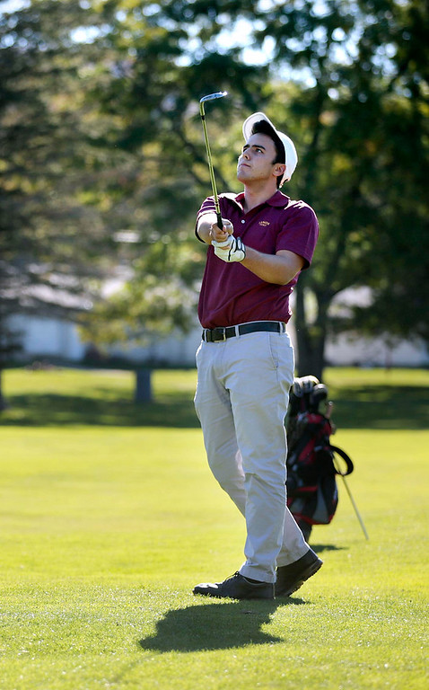 . Lenox\'s Kris Vahle hits his ball from the fairway during a golf match against Wahconah at Wahconah Country Club in Dalton. Monday, September 30, 2013. Stephanie Zollshan/Berkshire Eagle Staff.