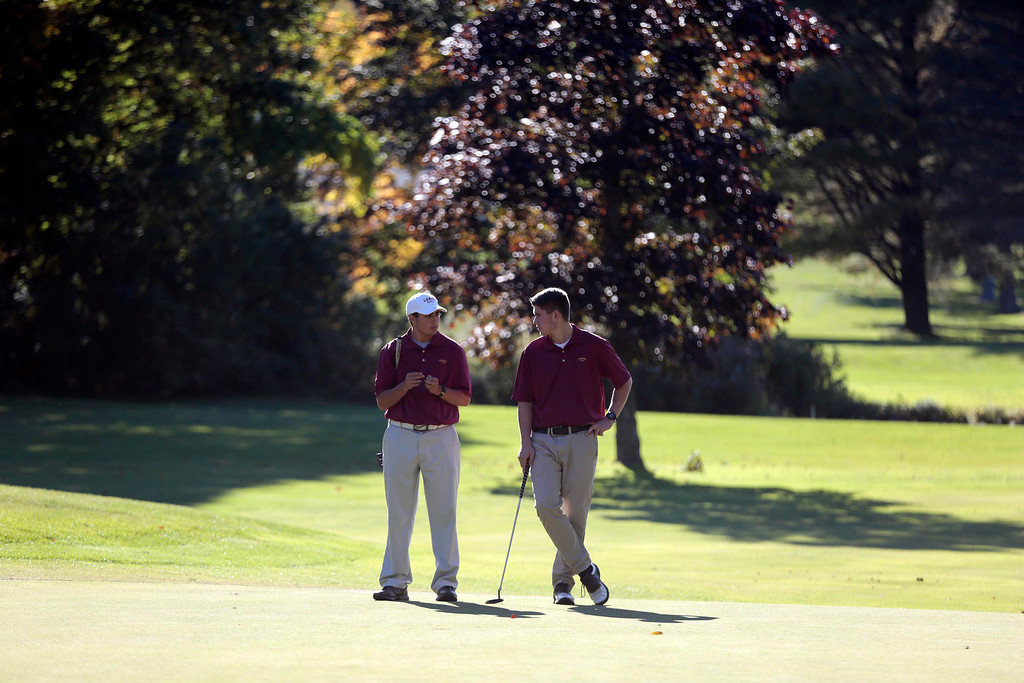 . Lenox\'s Cameron Sibley, left, and Zach Levesque chat on the green during a golf match against Wahconah at Wahconah Country Club in Dalton. Monday, September 30, 2013. Stephanie Zollshan/Berkshire Eagle Staff.