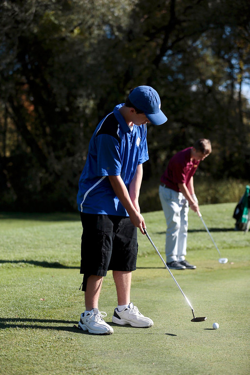 . Wahconah\'s Thomas Gonzales putts as Lenox\'s Noah Hunter, back, lines up his putt during a golf match at Wahconah Country Club in Dalton. Monday, September 30, 2013. Stephanie Zollshan/Berkshire Eagle Staff.