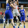 GEOFF SMITH - THE BERKSHIRE EAGLE<br /> Hoosac Valley junior Skylar Case goes up for a layup over the outstretched arm of Lunenburg's Sarah Morse in the MIAA Division III state semifinal at the DCU Center. March 13, 2017.