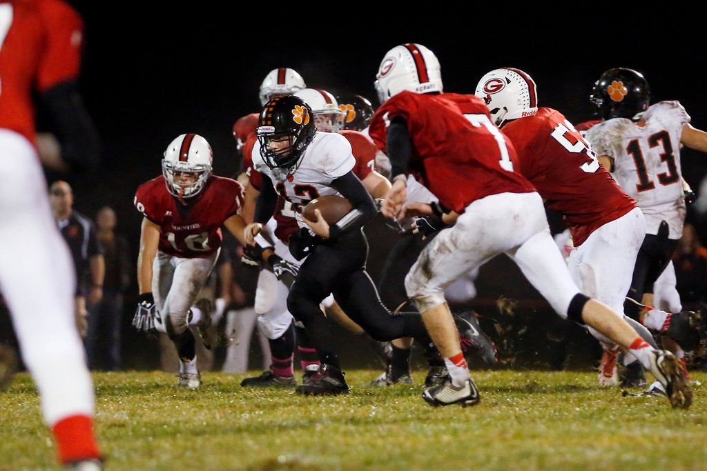 . Lee\'s Homer Winston runs through a crowd of Mount Greylock defenders in a football game at Mount Greylock High School in Williamstown. Friday, October 21, 2016. Stephanie Zollshan � The Berkshire Eagle | photos.berkshireeagle.com
