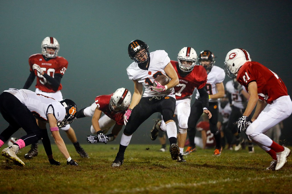 . Lee\'s Nic Castillo works his way through Mount Greylock defenders in a football game at Mount Greylock High School in Williamstown. Friday, October 21, 2016. Stephanie Zollshan � The Berkshire Eagle | photos.berkshireeagle.com