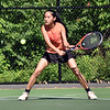 GEOFF SMITH — THE BERKSHIRE EAGLE<br /> Lee third singles player Suri Lee reaches down to hit the ball during the Western Massachusetts Division III championship against South Hadley. The Wildcats won 4-1.
