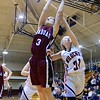 GEOFF SMITH - THE BERKSHIRE EAGLE<br /> Quaboag's Emma Stanton hauls in a rebound as Lee's Karli Retzel tries to get a hand on the ball during the Western Mass. Division IV championship game. March 11, 2017.