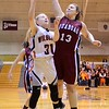 GEOFF SMITH - THE BERKSHIRE EAGLE<br /> Lee's Karli Retzel goes up for a shot as Quaboag's Lexi Paquette tries to block her shot during the Western Mass. Division IV championship game. March 11, 2017.