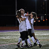 GEOFF SMITH — THE BERKSHIRE EAGLE<br /> Lenox's Mary Elliot, left, is hugged by teammate Julie Pehlert, center, and Nicole Gamberoni after Elliot scored her second goal of the night in the team's win over Ware in the Western Massachusetts Division IV semifinals Wednesday.