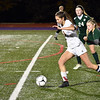 GEOFF SMITH — THE BERKSHIRE EAGLE<br /> Lenox's Abby Schilling pushes the ball past a pair of Ware defenders during a Western Massachusetts Division IV semifinal on Wednesday.