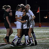 GEOFF SMITH — THE BERKSHIRE EAGLE<br /> Lenox's Mary Elliot, center, is hugged by her teammates after Elliot scored her second goal of the night in the team's win over Ware in the Western Massachusetts Division IV semifinals Wednesday.