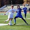 GEOFF SMITH — THE BERKSHIRE EAGLE<br /> Lenox's Andre Collins goes to strike the ball while Drury's Caleb Besaw tries to poke it away during Sunday's Western Massachusetts Division IV championship game.