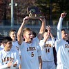 GEOFF SMITH — THE BERKSHIRE EAGLE<br /> Lenox senior Mike Abdalla holds up the Western Massachusetts Division IV championship trophy after the Millionaires defeated Drury, 4-0, on Sunday afternoon.