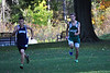 McCann junior William Rivard, sprints to the finish and passes a Franklin Tech runner during a cross country meet on Tuesday, Oct. 8, 2013. Rivard was the third McCann boy to cross the finish line. (Jack Guerino/ North Adams Transcript)