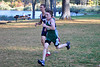 McCann sophomore Lukas Yelle, sprints past a Franklin Tech runner and is the second McCann runner to cross the finish line during Tuesday's cross country race. (Jack Guerino/ North Adams Transcript)