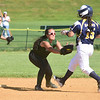 GILLIAN JONES - THE BERKSHIRE EAGLE<br /> McCann's Kalley Vanuni tags out a Hopkins runner during the Division III Western Massachusetts softball at McCann Tech which went on to beat Hopkins 6-4. Monday, June 11, 2018.