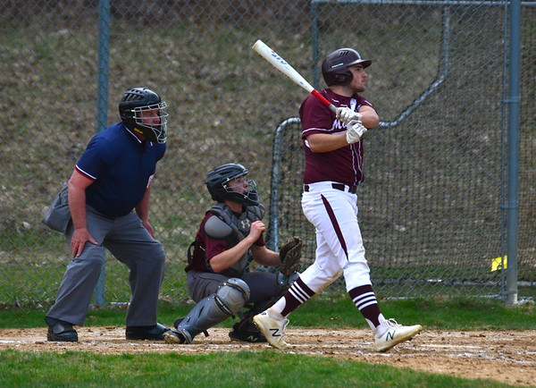 GILLIAN JONES — THE BERKSHIRE EAGLE<br /> Monument's Sean Dupont hits a single that gets Sam Cormier home to bring the score to 10-1 in the fifth inning in a game against Lenox at War Memorial Field. Monument beat Lenox 13-2.